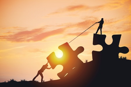 Photo pour Silhouette people helping to connect jigsaw and puzzle to success - image libre de droit