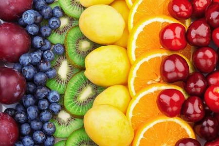 Foto de Fresh fruits.Assorted fruits colorful background. Color range - Imagen libre de derechos