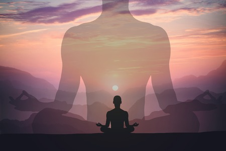 Photo for Man meditating yoga at sunset mountains. Travel Lifestyle relaxation concept. Double exposure shot - Royalty Free Image