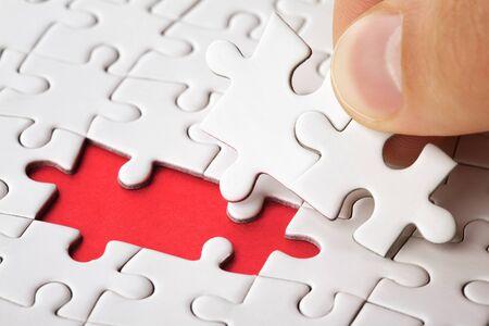 Photo pour Hand put the last piece of puzzle to complete the mission - image libre de droit