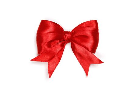 Foto de Red satin gift bow isolated on white background. - Imagen libre de derechos