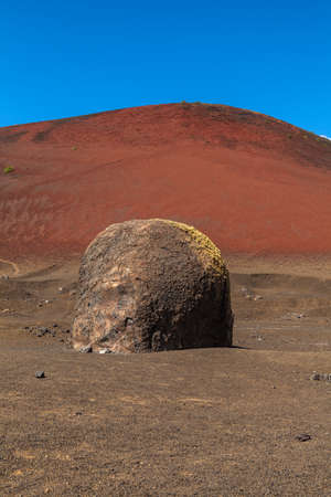 Volcanic bomb near Montana Colorada in Lanzarote, Canary Islands, Spain.