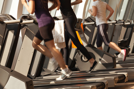 Photo for gym shot - people running on machines, treadmill - Royalty Free Image