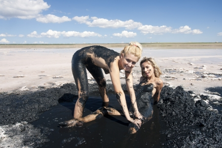 Two naked girls on a salt lake