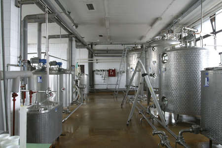 stainless steel pipes and tanks in dairy food production plant