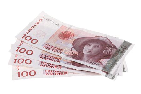Four Norwegian 100 kroner bills isolated on white
