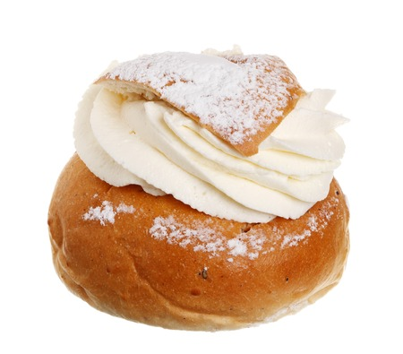 One Swedish Semla, also called Shrove Bun, fettisdagsbulle, consists of light wheat bread with almond paste and whipped cream filling  Serve it with hot milk called hetvÀgg  Isolated on white background
