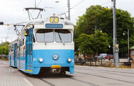 Gothenburg, Sweden - July 1, 2014: Tram Type M29 number 841 on line 2 with the destination Hgsbotorp on Stampgatan at the tram stop at Drottningtorget.