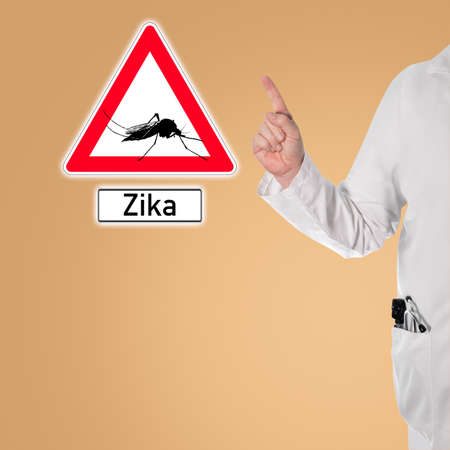 Doctor warns of dengue next to a sign with a mosquito and the text Zika