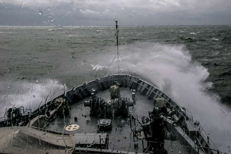 Foto de Ship in sea storm. Storm at Baltic sea. Warship training in the Baltic Sea during a storm. NATO military ship in Baltic sea, Latvia. NATO military ship at sea during a storm. view from ships the bow. - Imagen libre de derechos
