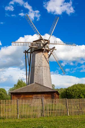 Dutch windmill with blue sky and clouds background: Royalty