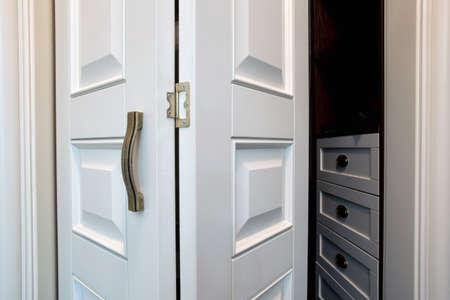 Foto de White wooden sliding door in modern house close-up - Imagen libre de derechos