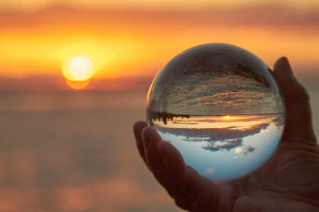 Photo pour The sun sets over Lake Constance in Germany and lit by a crystal ball. - image libre de droit