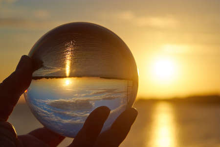 Foto de The sun sets over a river in Germany and lit by a crystal ball. - Imagen libre de derechos