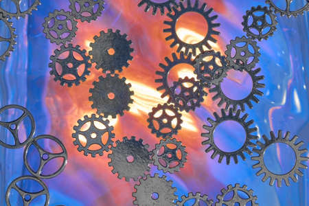 Several gears in front of a blurred and luminous background.