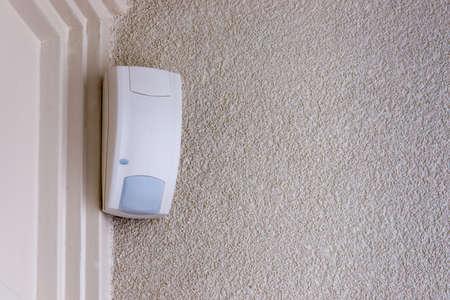 Photo pour pasive infrared  sensor mounted in the corner of a room - image libre de droit