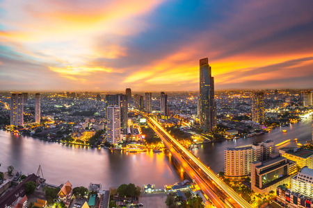 Skyscraper on night scene cityscape at Chaopraya river in Bangkok metropolis Thailand