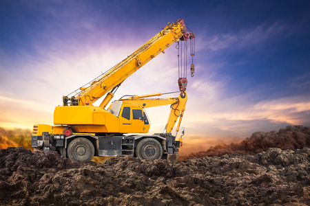 Photo for Auto crane on the ground at construction site with sunset background - Royalty Free Image