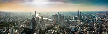 Foto de Skyscraper on cityscape at Chaopraya river in Bangkok metropolis Thailand on sunset time - Imagen libre de derechos