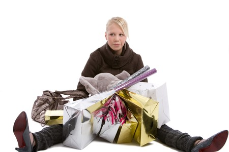Young teenage girl sitting on the floor with all her shopping bags around her