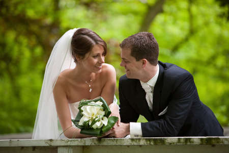 Beautiful bride and groom looking very happy on their big day
