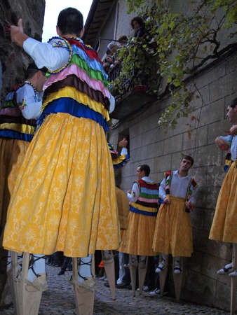 Anguiano dancers in La Magdalena celebration dancing with stilts down the street