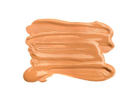 Photo pour Light beige makeup smear of creamy foundation isolated on white background. Light beige creamy foundation texture isolated on white background - image libre de droit