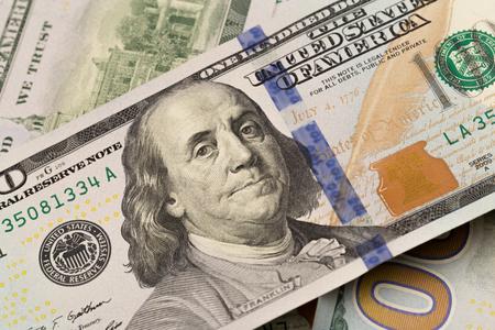 Foto de Dollars closeup. Benjamin Franklin's portrait on a bill.Concept of money and earnings. - Imagen libre de derechos