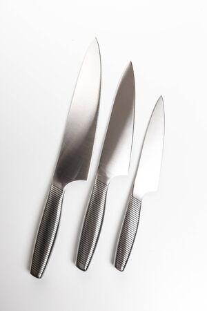 Photo pour Set of steel kitchen knives on white background . - Изображение - image libre de droit