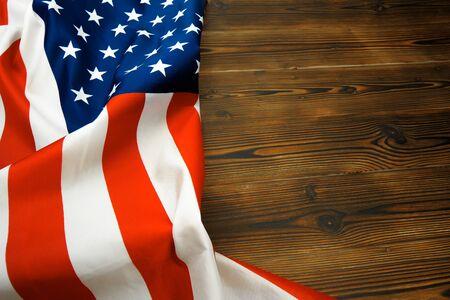 Photo pour American flag on a old wooden desk top view - Image - image libre de droit