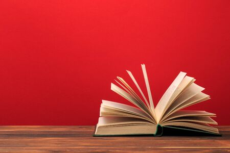 Photo for Open book  on red background. text place  - Image - Royalty Free Image