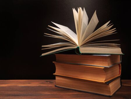Photo for Open book on the blackboard background. - Image - Royalty Free Image