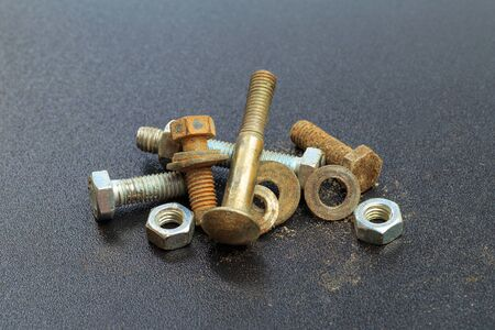 Foto de old Screw , nuts, rivets on black background . - Image - Imagen libre de derechos