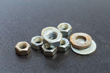 Photo pour old Screw , nuts, rivets on black background . - Image - image libre de droit