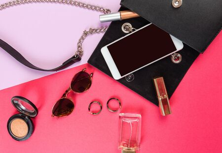 Photo pour Top view of Women bag and lady stuff with copyspace on colour  background - image libre de droit