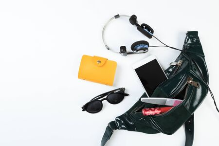 Photo for Fashion concept : Flat lay of leather woman bag open out with sunglasses and smartphone on white background. - Royalty Free Image