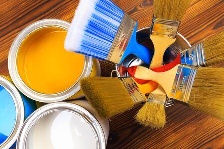 Foto de House renovation, paint cans on the old wooden background with copy space - Imagen libre de derechos