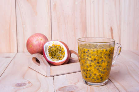 Passion fruits on wooden background.  as package design element