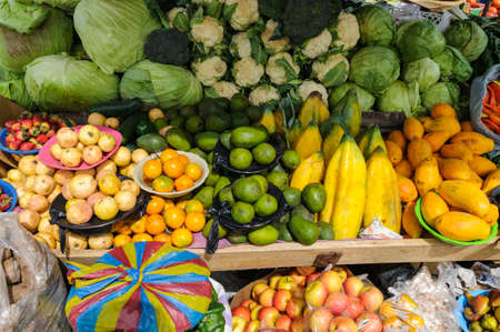 Market stall at a farmers market with fresh fruits and vegetables.の写真素材