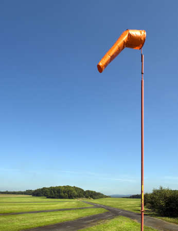 Wind sock at an airfield on clear day