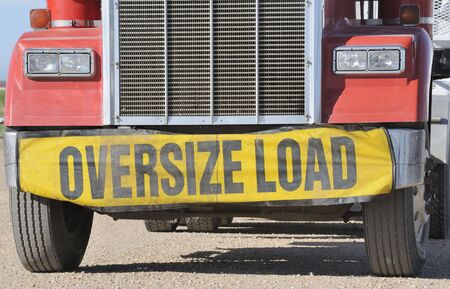 Closeup of oversize load sign on front of truck