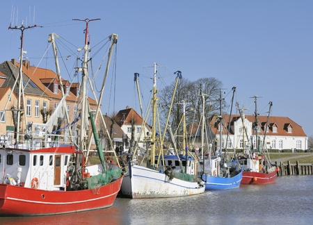 Colored fishing boats in harbor, Tonner, Germany