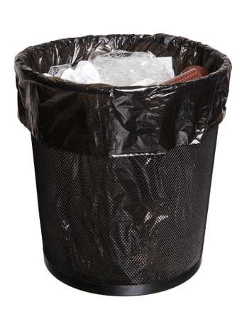 black mesh office bin full of garbage, isolated on white