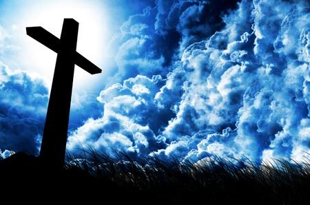 shining cross against dramatic cloudy sky