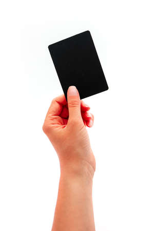 Photo pour Female hand showing a black card, isolated on white background. - image libre de droit