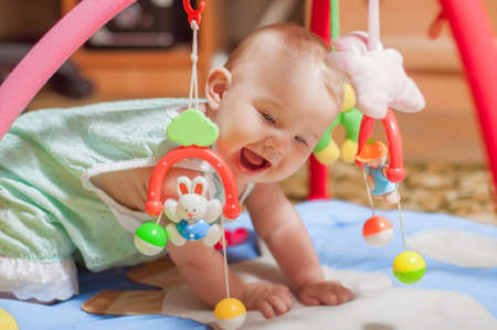 Photo for little baby playing with toys at home - Royalty Free Image