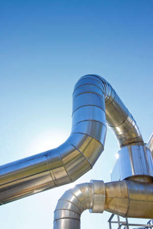 Geothermal power pipe structure against a blue background - image with copy space