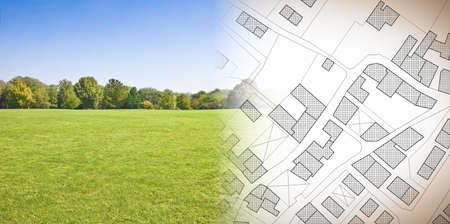 Photo for Planning a new city - concept image with hand drawing an imaginary cadastral map of territory with buildings, fields and roads against a green area - Royalty Free Image