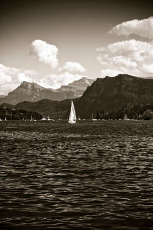View of Lucerne Lake. Sportsman sailing in Lucerne lake. Sepia toned image