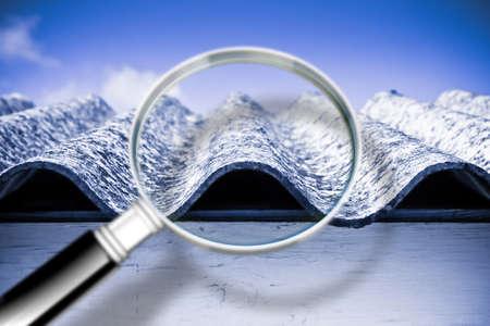 Foto de Analysis of the compounds of a dangerous asbestos roof - concept image - Imagen libre de derechos